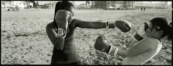 I recently bought a sweet, used panorama camera. This photo  is from my first field trip. Elora and Sammy practice Muay Thai on Main Beach, Santa Cruz.