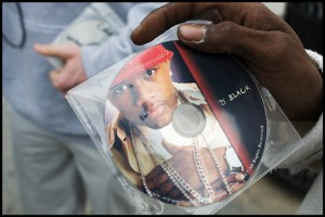 D Black hawking his CD along the Venice Beach boardwalk.