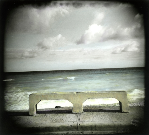 After nearly a week of frosty mornings I started thinking of warmer places. I recently prionted and hand colored this Holga photo. It was taken last fall along Route 44 on the Dominican Republic's southwest coast.