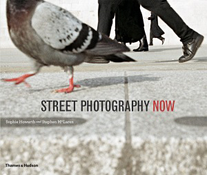 If you're interested in street photography or just good photography, check out this book by Sophie Howarth and Stephen McLaren. It features forty-six of the world's top street photographers, hundreds of outstanding photos and four readable essays. It's one of the better photo books I've seen/read in a long time. It made me want to grab my camera and a cup of coffee and hit the street.
