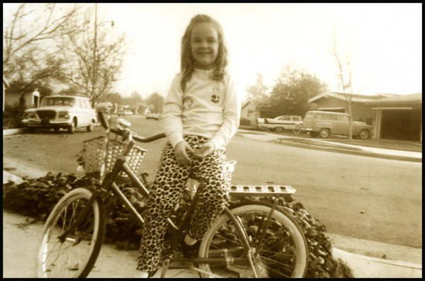 Here's one from the archives. Dig the leopard print pants and early cruiser bike. Happy Birthday Julie!
