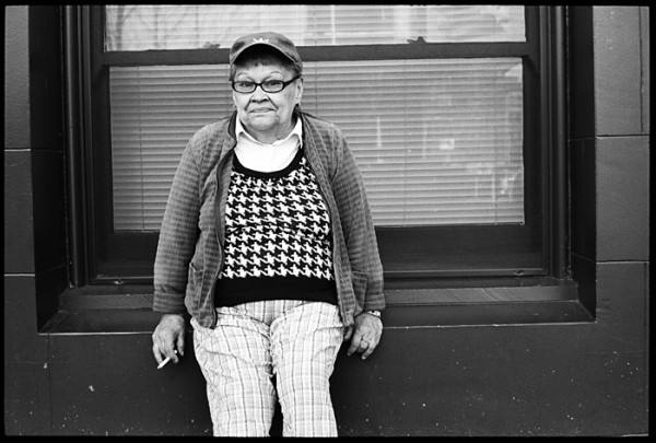 The window seat, baseball cap and black and white vest with the plaid pants caught my eye. Chatting with her was a pleasure.