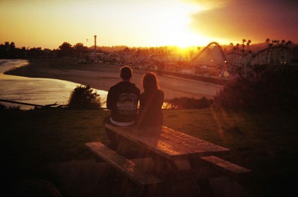 I took this one a couple of months ago. It's a quick grab shot with my Holga 135BC and Kodak 200 ISO film. I liked the couple, the beach, the Boardwalk and the light.