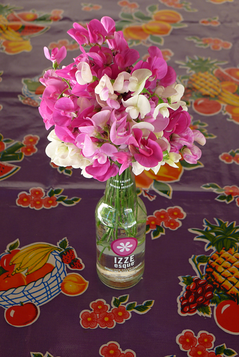 "How much color is too much?  Pre-4th of July sweet peas and a wild table cloth at ""the farm""."