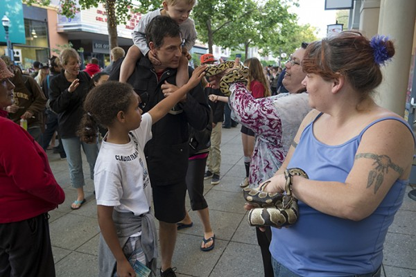 And a couple of women with snakes getting some attention.