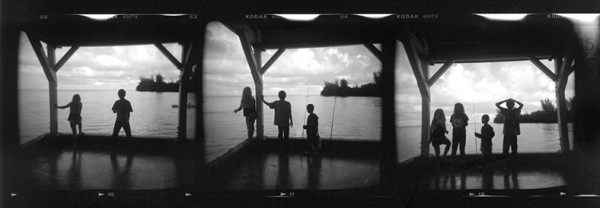 Morning on the pier, Hanalei Bay, Kauai. This is three consecutive frames on a contact sheet. The kids were watching a bird dive for fish.
