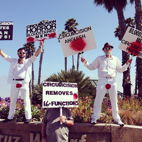 While biking around town this afternoon checking out the post Memorial Day weekend scene, I happened upon an anti-circumcision protest at the entrance to the wharf.