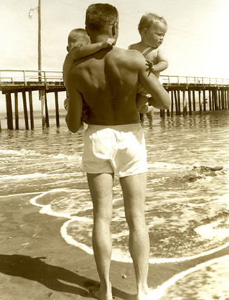 Dad with my sister Lynn and me, Avila Beach, California around 1956.