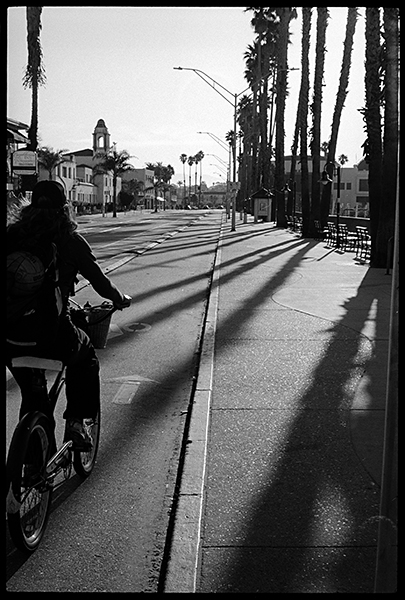 An empty Beach Street greets an early morning .bicyclist