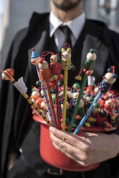 University students selling pencils to fundraise for graduation expenses. The university is the most prestigious in Portugal.