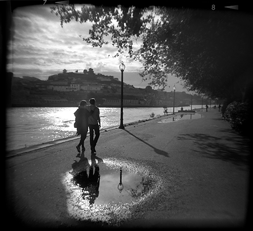Olive and Cooper walk along the Rio Douro in Porto, Portugal. Port is one of the most picturesque cities I've ever visited.