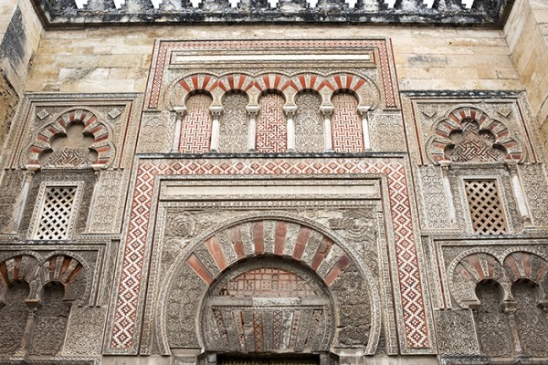 The Mezquita, once was a mosque. It was built in 785 on the foundation of a Christian church. In 1236, after Córdoba was recaptured by Fredinand III, the Mosque was reconverted into a Christian church. The Mosque was modified but still contains many Moorish architectural features.