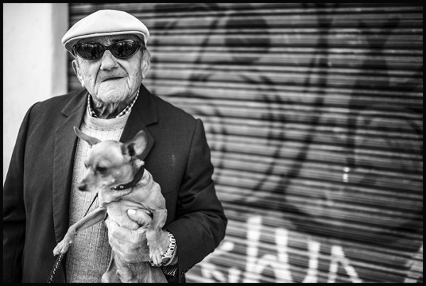 """When I asked, """"Te puedo sacar una foto?"""" He said, """"Si!"""" and picked up his dog."""