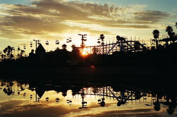 Feet dangling, eye opening sunset at the fun zone!