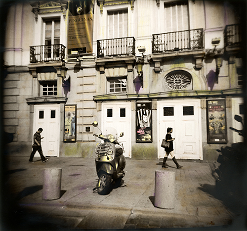 I'm currently working on a series of hand colored, silver prints from travels in Spain, Portugal and Morocco. All the photographs were made with plastic Holga cameras. The film was hand developed and printed in a darkroom. This one is from Plaza de Santa Ana, Madrid, Spain