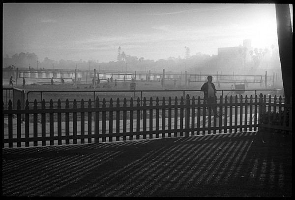 This scene caught my eye. The hazy light, vertical and horizontal lines and the lone figure relaxing against the rail make an interesting composition.
